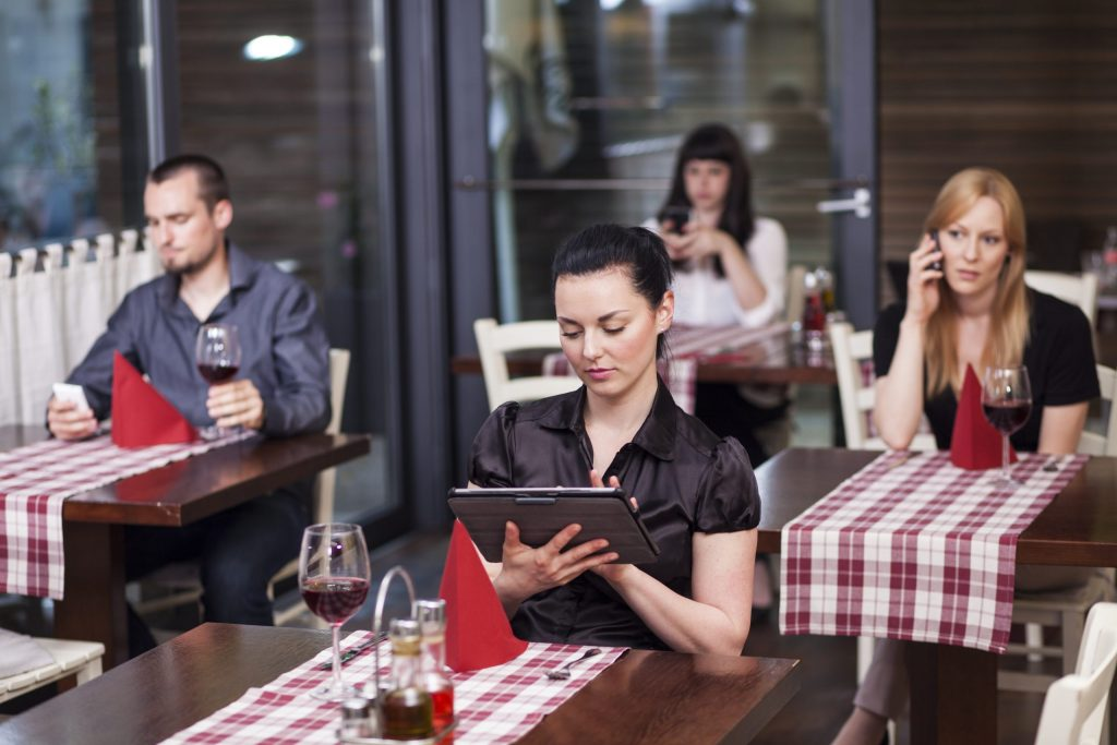 restaurant with people with bad habits